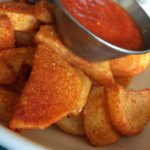 Patatas Bravas (seasoned fried potatoes, alioli, smoked tomato sauce